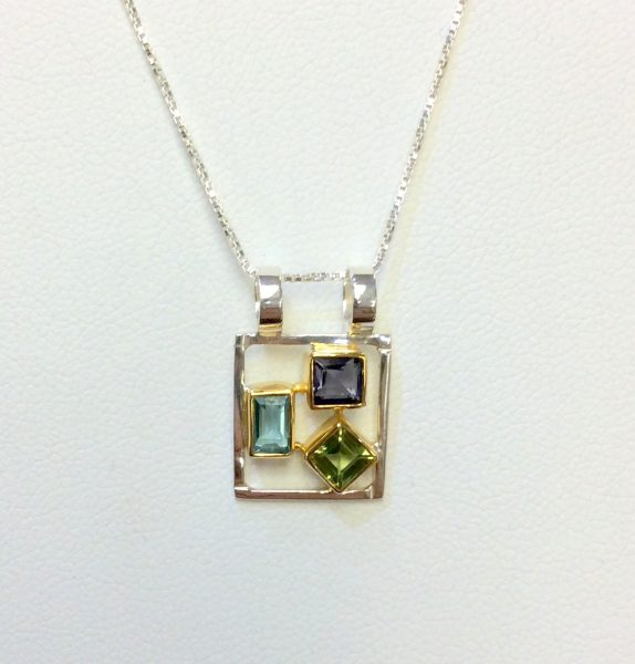 Gemstone pendant featuring iolite, peridot, and amethyst in a sterling silver setting