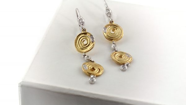 14K yellow gold earrings with white gold and diamond accents.