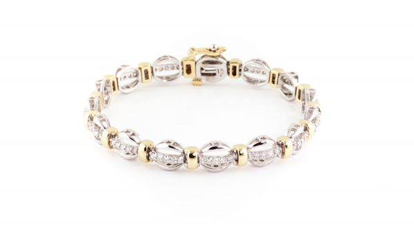 Diamond bracelet in 14K yellow and white gold.
