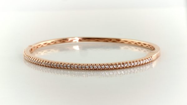 Diamond bangle in 14K rose gold.