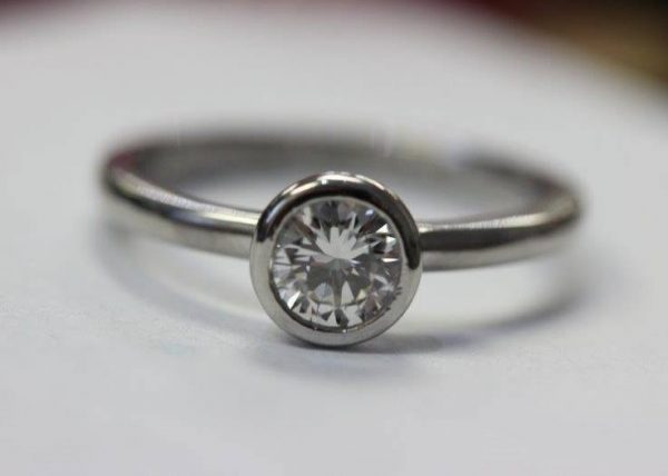 Custom designed bezel set diamond engagement from Barbara Oliver Jewelry
