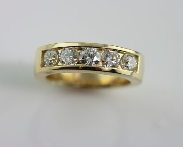 Custom men's wedding band in yellow gold with diamonds