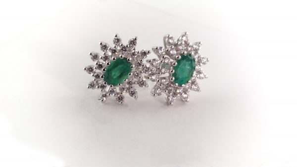 Emerald and diamond earrings in 14K white gold.