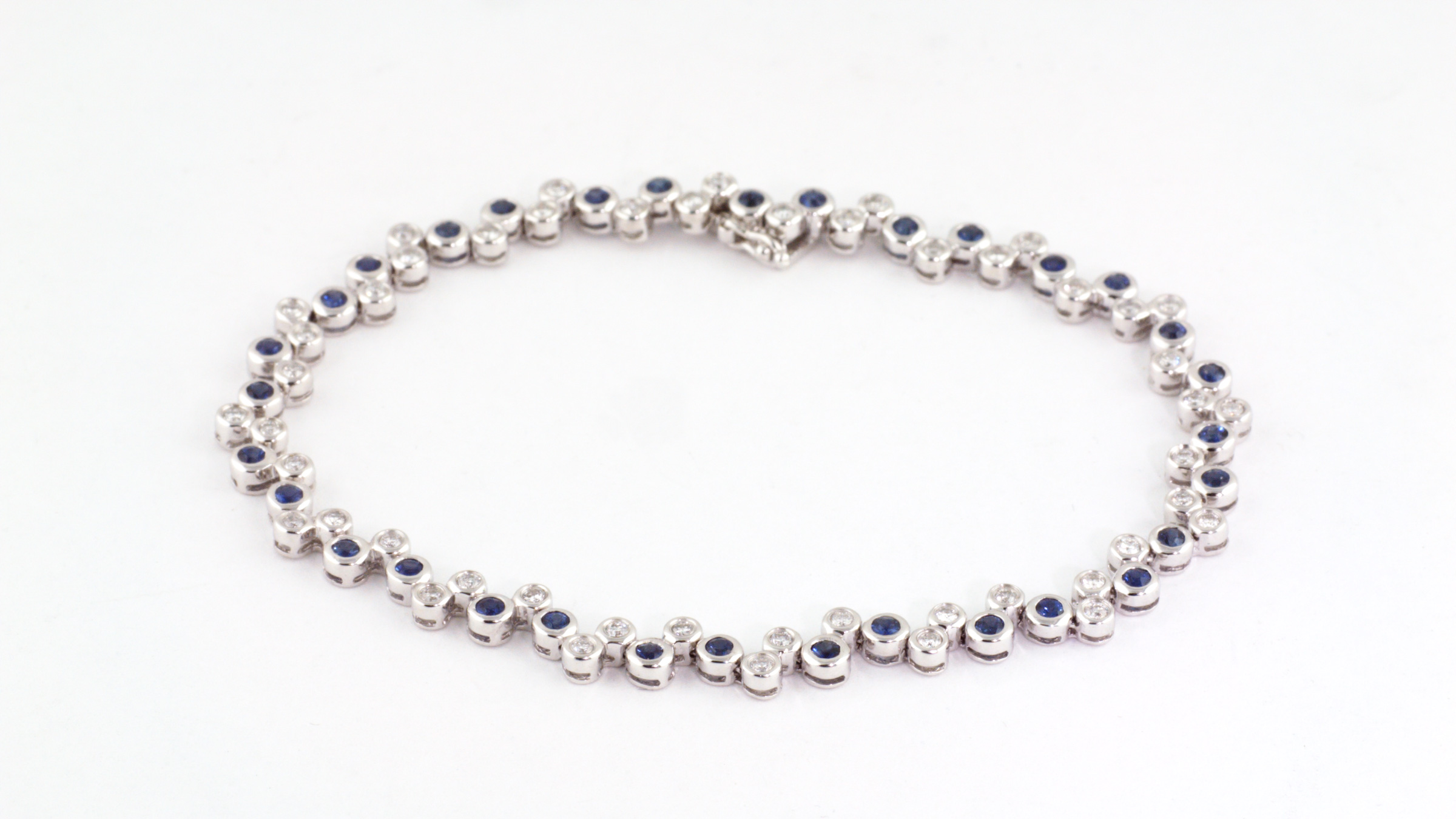 Sapphire and diamond bracelet in 14K white gold.