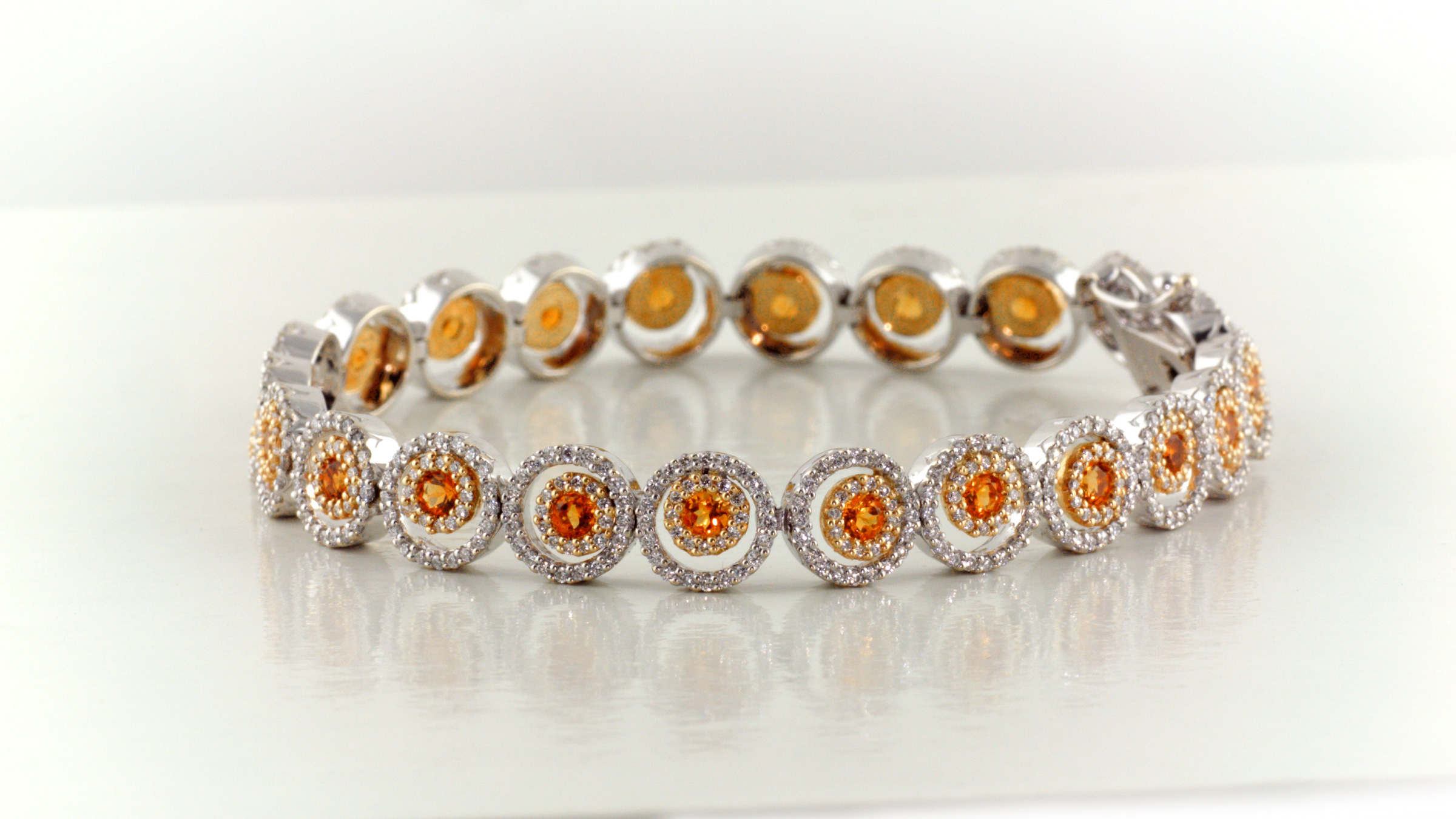 Diamond and citrine bracelet in 14K white gold.
