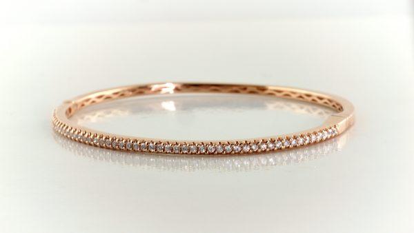 Diamond bangle in 14K rose gold.