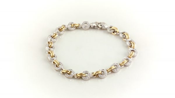 Diamond bracelet in 18K white and yellow gold.