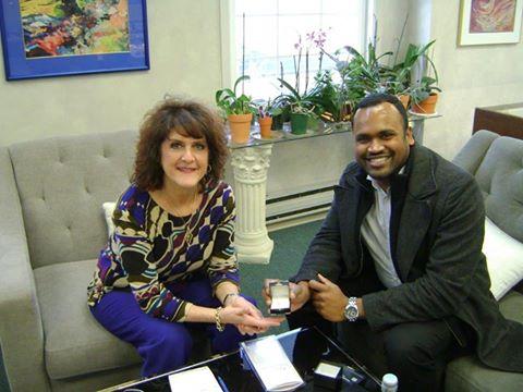 Barbara Oliver and customer with custom designed bezel set diamond engagement ring